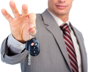 bigstock-hand-with-a-car-key-30094400